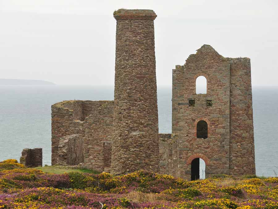 Ruined buildings at Wheal Coates, near St Agnes, Cornwall. Two whim engine houses are visible. Wheal Coates is a beautiful 1.5 mile walk from the St Agnes Hotel, Cornwall